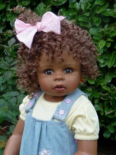 "Masterpiece Dolls ""Jordyn"" Brunette ~ ~ First African American doll in the 29"" size from Monika Levenig. Beautiful face expression. The look of a 1 yr old adorable child. Brunette hair w/ ringlets & brown eyes. Denim jumper w/ pretty appliques & patchwork multi designed ruffle. Soft yellow shirt.  Pretty big pink bow in her hair & coordinating pink shoes  & striped socks."
