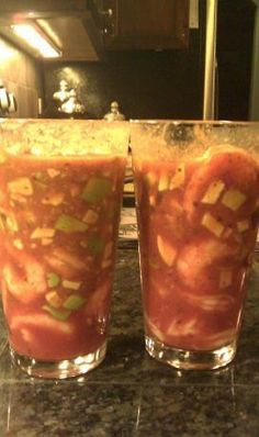 Summer Mexican Shrimp Cocktail Served in a Large Glass... (Shrimp-Avacardo-Orange Juice-onion-cucumber-Tomato sauce)..Summer Starter..