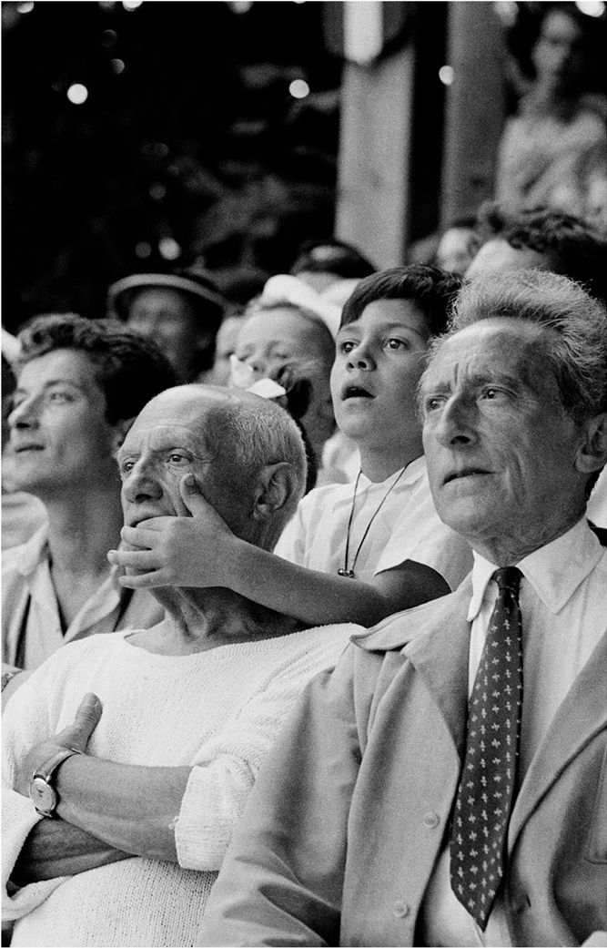 Pablo Picasso, son Claude and Jean Cocteau at the bullfights - Vallauris, France, 1955.