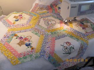 If I make pieced or embroidered hexagons, i can always mount them up like this or log-cabin stylee. Nice effect!