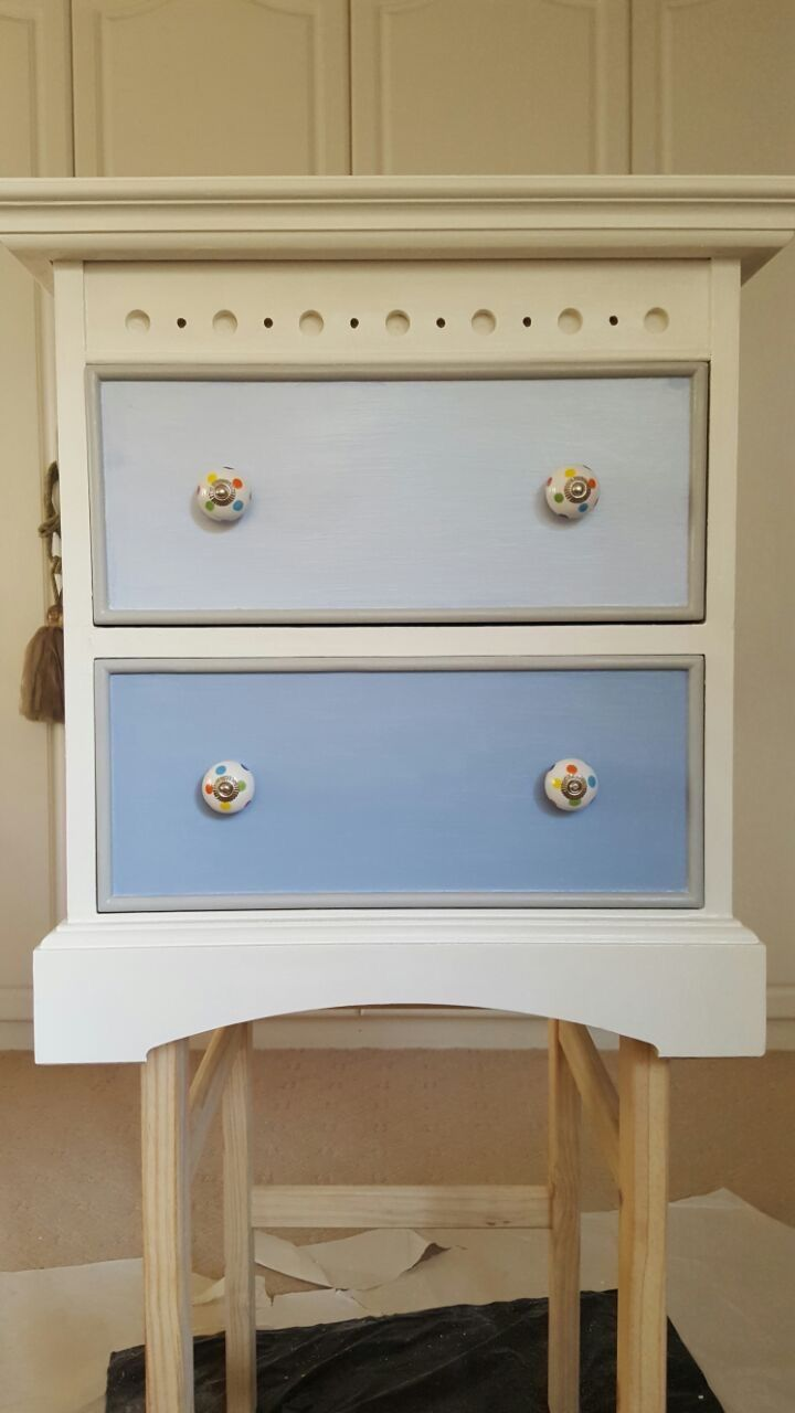 Bev repainted this wooden cupboard in Annie Sloan Chalk Paint Old White. We used Greek Blue on the bottom drawer and mixed Old White into the blue for the top drawer. Bev sourced the funky polka dot handles and after 3 coats of Harlequin Satin Decorators Varnish it will be ready for her new grandson's nursery!