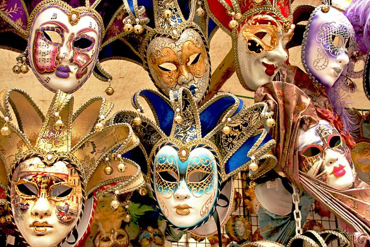 Drama masks displayed in front of one of the stores on the Rialto Bridge in Venice, Italy