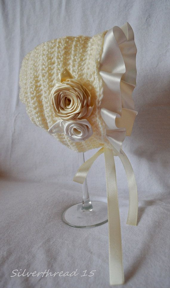 Crochet bonnet with ribbon embellishment