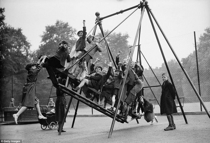 The swing's the thing: Fifteen children enjoy a ride in London's Bloomsbury. These delightful images were all captured in the days before the health and safety industry took root, in an age when childhood  disease or war represented  more pressing threats to a child's prospects than a game of conkers.