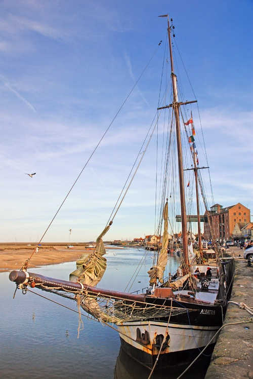 The fine Albatross sailing ship moored at Wells next the Sea Harbour was built in Rotterdam in 1899.  Norfolk