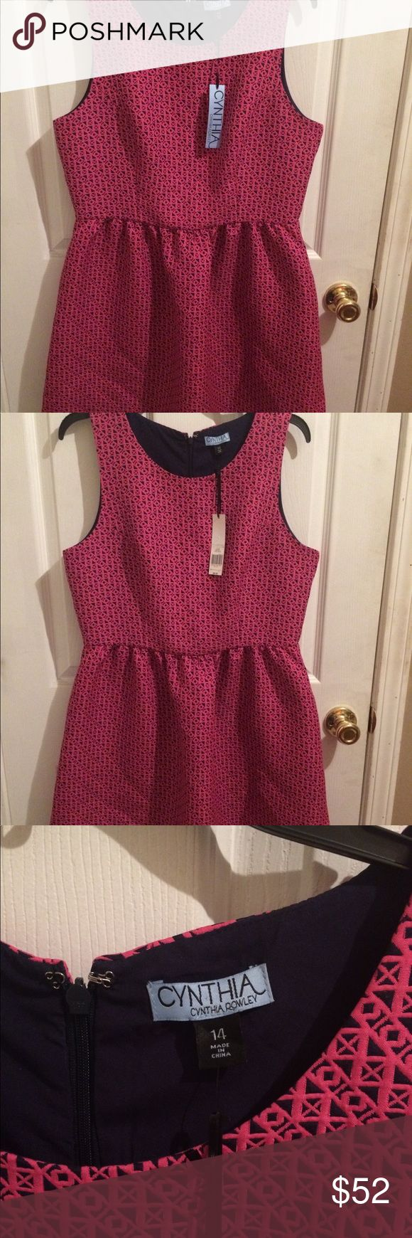 Cynthia Rowley Dress Brand new Cynthia Rowley Dress with tags! It's pink and navy blue. It's a women's size 14. Came from Belk and retails at $99.00. Cynthia Rowley Dresses Midi