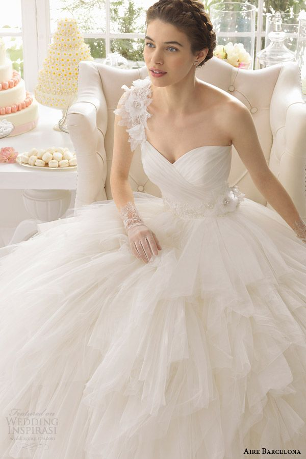 Fabulous aire barcelona anouk one shoulder ball gown wedding dress tiered skirt close up bodice