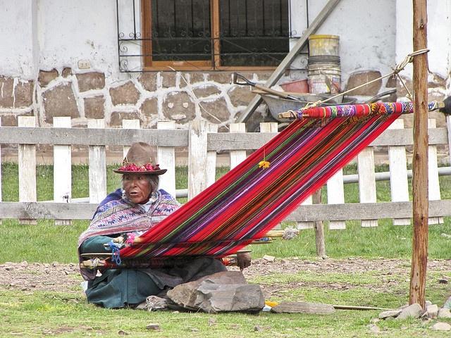 Weaving on a backstrap loom.