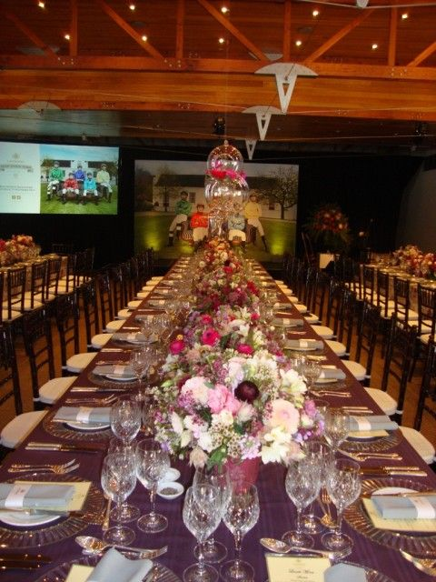Long Table With Elegant Setting with Projector Screen in the Background