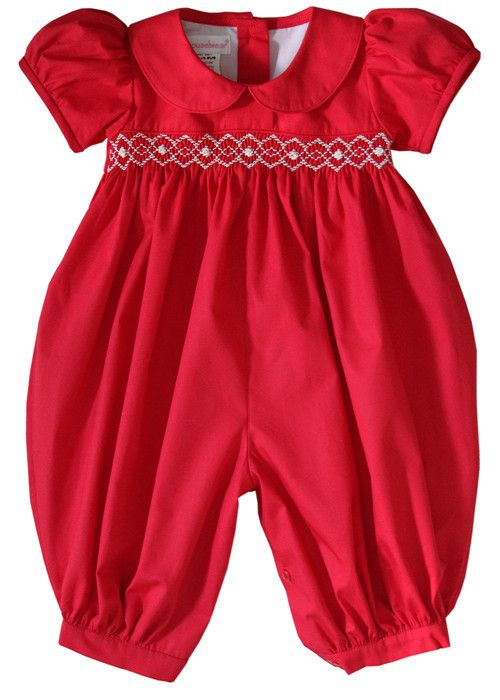 Abigail is our holiday baby girl long bubble, it is made in the perfect shade of Red Christmas color, and showcases a beautiful piped Peter Pan, the delicate smocking design below the pleated yoke is