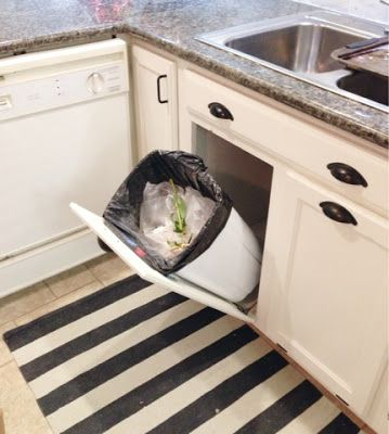 Tip out trash cans under the sink!