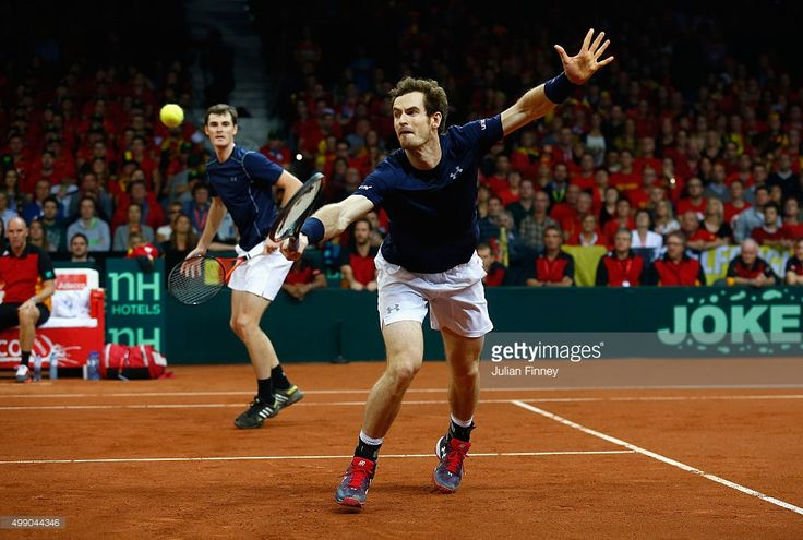 Jamie Murray and Andy Murray of Great Britain in action against Steve Darcis and David Goffin of Belgium in the doubles during day two of the Davis Cup Final between Belgium and Great Britain at Flanders Expo on November 28, 2015 in Ghent, Belgium.