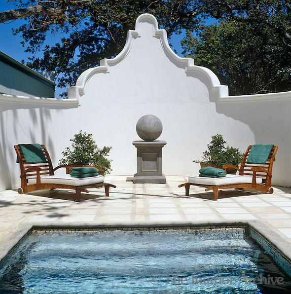 Enclosed terrace with steps leading down into the swimming pool in the foreground. South Africa