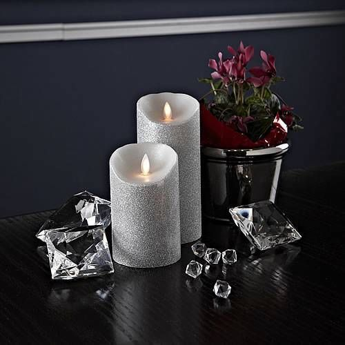 SILVER-Reallite-Real-Genuine-Wax-Flicker-Flameless-LED-Candle-Moves-Randomly.  Buy them here: http://www.ebay.ca/itm/SILVER-Reallite-Real-Genuine-Wax-Flicker-Flameless-LED-Candle-Moves-Randomly-/190965175271?ssPageName=STRK:MESE:IT