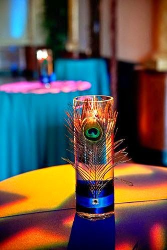 Make Your Wedding Ceremony a Unique One With the Peacock Theme Party   Wedding Candle Centerpieces. http://simpleweddingstuff.blogspot.com/2014/06/make-your-wedding-ceremony-unique-one.html