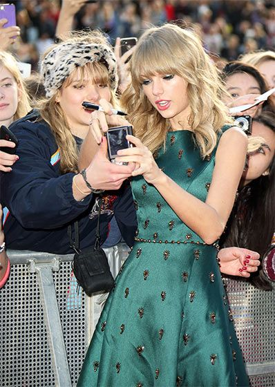 Taylor Swift posed for pictures with her fans as she attended the BBC Radio 1 Teen Awards at Wembley Arena in London, England.