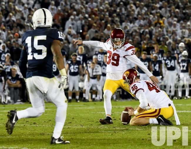 USC Trojans place kicker Matt Boermeester (39) kicks a 46-yard field goal to win the game as time expires to give the Trojans a 52-49…