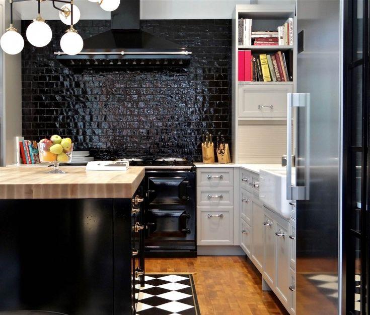 black tiled backplash black appliances black hood black island white cabinet wooden countertop ceiling lamps wooden floor of Irresistible Kitchen with Black Appliances Ideas