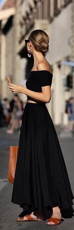 Quite possibly one of the outfits of the season captured with amazing detail by The Sartorialist. That black off the shoulder top and matching skirt with the brown sandals and bag… To die for