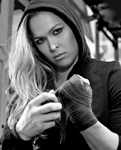 Ronda Rousey :) If you don't know her then you aren't a UFC fan of MMA.  They just recently allowed women into the competition and she is one bad  ass chick.