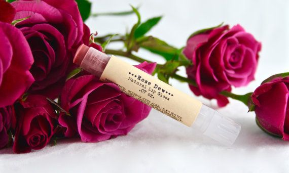 Rose Dew Lip Gloss...a delicately fresh detail.  A soft coral pink with a touch of shine, this ultra-feminine lip-gloss is perfect for ladies that are as sweet as they come. This proprietary blend glides on ridiculously smooth and allows your natural lip color to shine through. Looking for a bolder statement? Apply on top of your go-to lipstick to add some depth to your look. This natural lip color is free from any synthetic flavors and scents and is tinted only with cosmetic-approved micas…