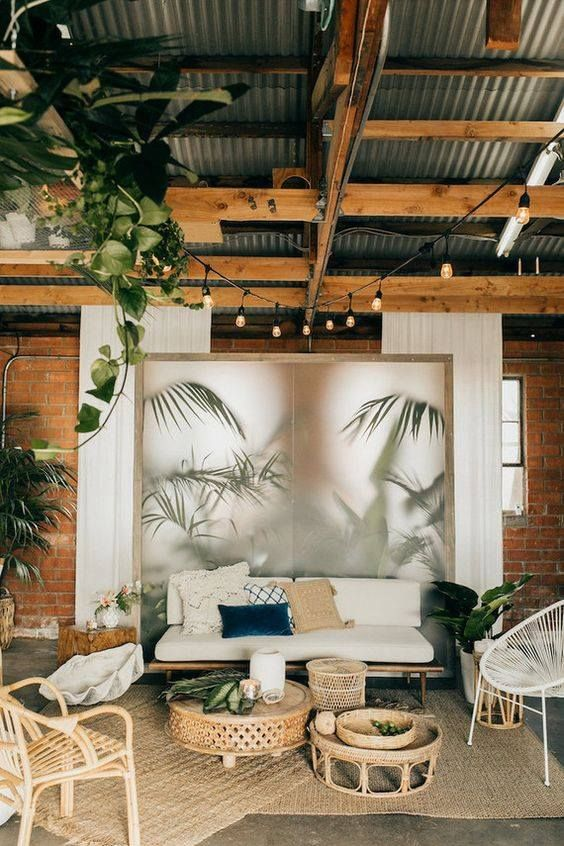 White chairs, table and palm print wall.