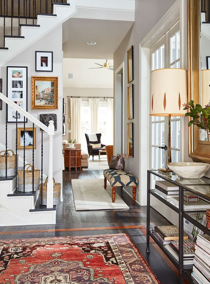 Stylist Natalie Nassars Atlanta home has a narrow entry that shes outfitted with a narrow entry console and an oversized mirror