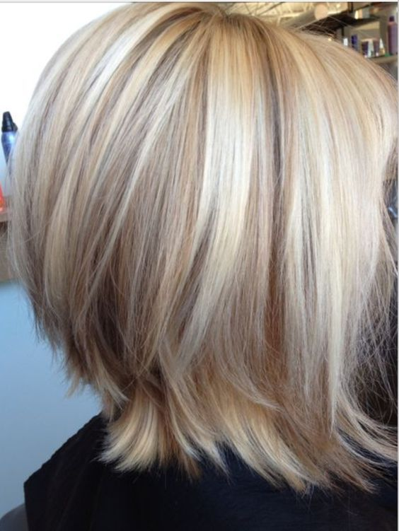Edgy bob, ends flipped, highlights very light blonde cool shades
