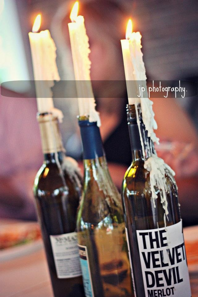 Old wine bottles made great rehearsal dinner decor. Or in our case - scotch bottles!