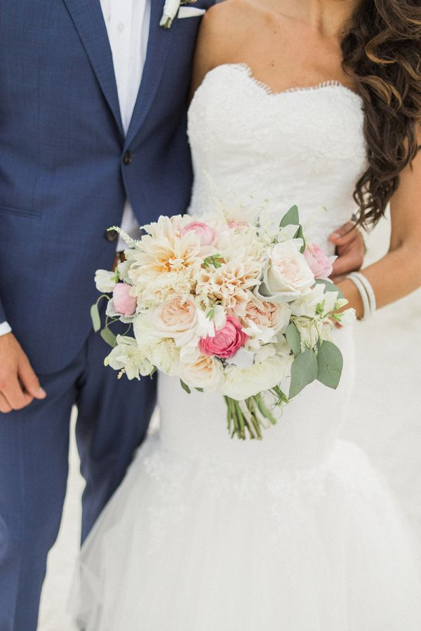 Colorful beach inspired ranunculus, rose and chrysanthemum wedding bouquet: http://www.stylemepretty.com/2017/01/06/shabby-chic-seaside-wedding/ Photography: Olimb - http://www.olimbphotography.com/