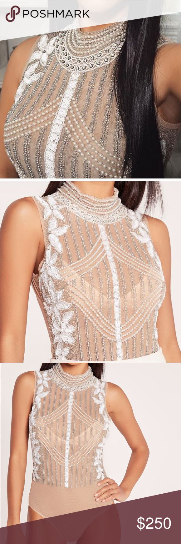 Vlogger Favorite Pearl Embellished BodySuit! This body suit is Sold out at retail stores! Limited Quantities Made. Worn once, includes extra beads. A Must Have in every fashionistas collection! This is a once in a lifetime piece Tops