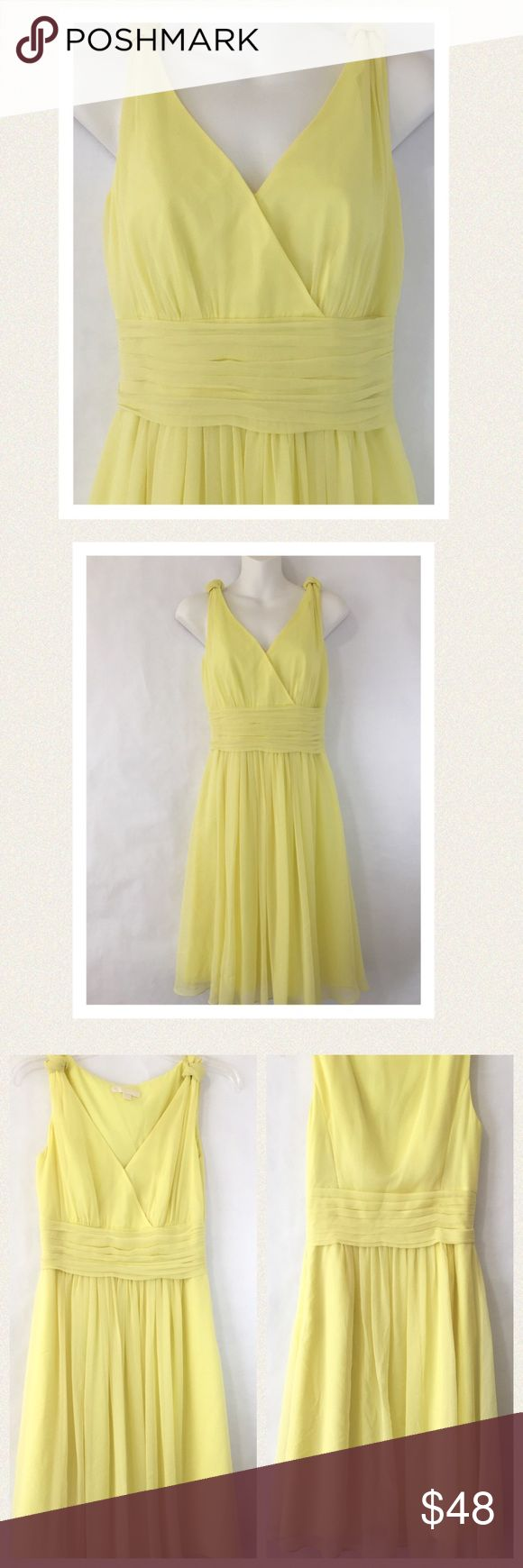 """Ann Taylor silk chiffon dress Light as a whisper,!this lovely silk chiffon dress in daffodil yellow fits like a dream. It features a flattering decollate neckline with a wide shirred waistline and decorative knot ties at the shoulder. Zips up the side. Fully lined with double lining in skirt area. Lining is polyester. Dress was worn once In excellent condition but has a pinhead size hole in back near hem. (See last photo) 🔹bust 34"""" 🔹waist 26.5"""" 🔹hips 36"""" 🔹chiffon length 38"""" lining length…"""