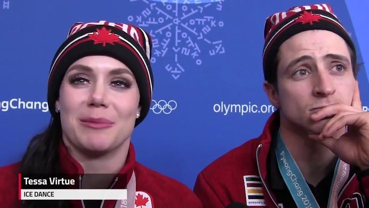 Canadian figure skaters were 'screaming' the national anthem - YouTube