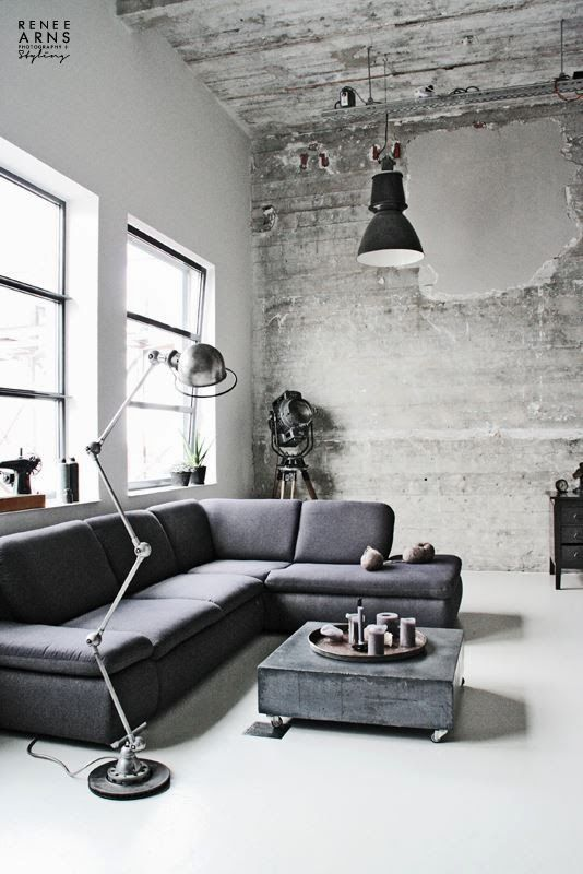 This looks slightly too industrial probably because it is too empty. The couch and coffee table match too much. They should have been complementary shades not exact matches.
