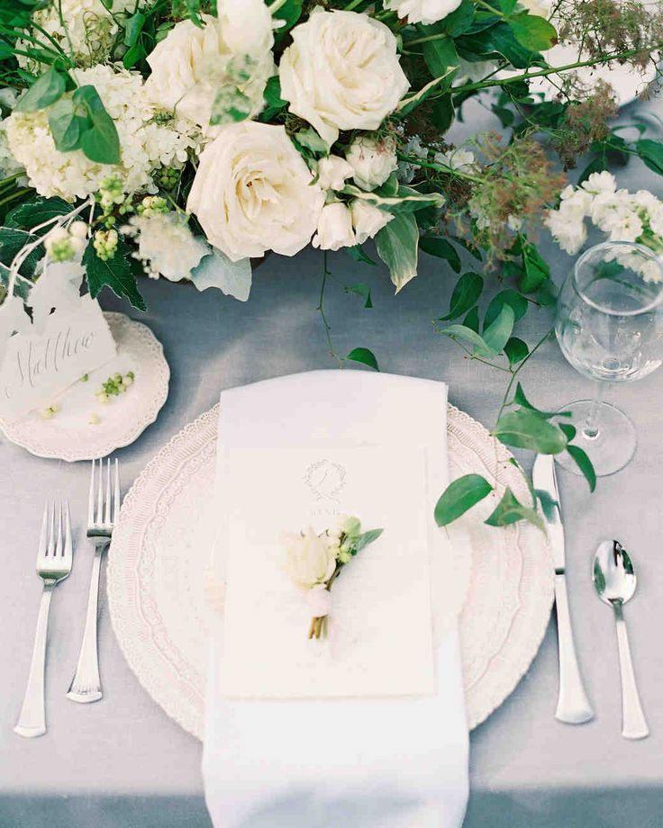 An Intimate Garden Wedding at a Michigan Bed & Breakfast | Martha Stewart Weddings - The bride used calligraphy to create a custom menu printed on handmade paper. It was placed atop a napkin and lace charger at the dinner table, with a sprig of greenery adding a pop of color. #weddingflowers #weddingideas #calligraphy #wedding