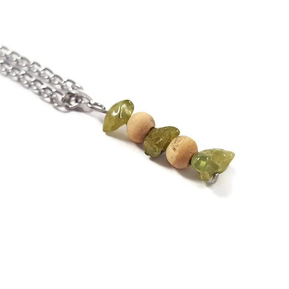 "In the ""Ayïn"" #Jewelry, you will find #necklace with #silvery #pendant adorned with three #peridots and two #wooden #beads.   #Handmade #jewelry, all #jewels are exclusive #creations, all manufactured by me within a choice of the best quality #stones, #gemstones and #healing #crystals. Your #jewel is made with love and positive energy.  #etsy #etsyjewelry #womanjewelry #gemstonejewelry  https://www.etsy.com/listing/203816666/handmade-jewelry-peridot-bohemian"