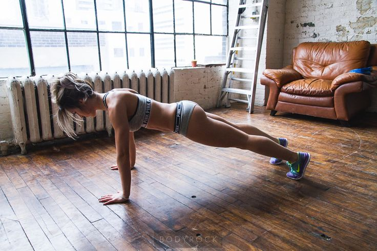 Begin in a high plank. Shoulder rolled back and down, legs stretched and pelvis tucked underneath you