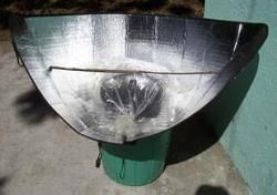 Solar Cooker made from a car windshield shade. Not good for windy environment, but great otherwise.