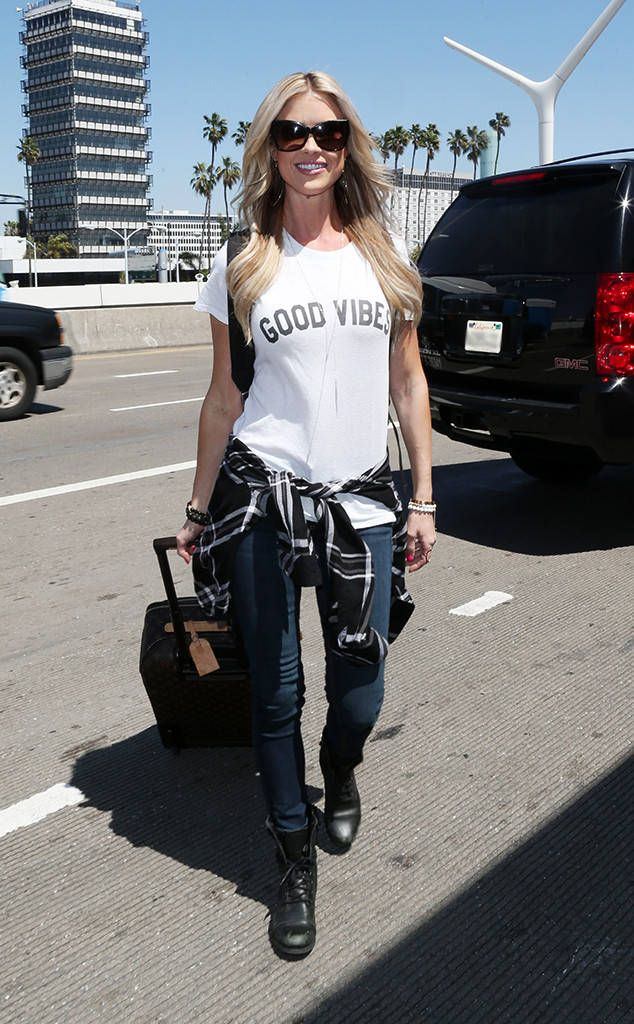 Good Vibes! The star shows off her unique style while making her way through LAX.