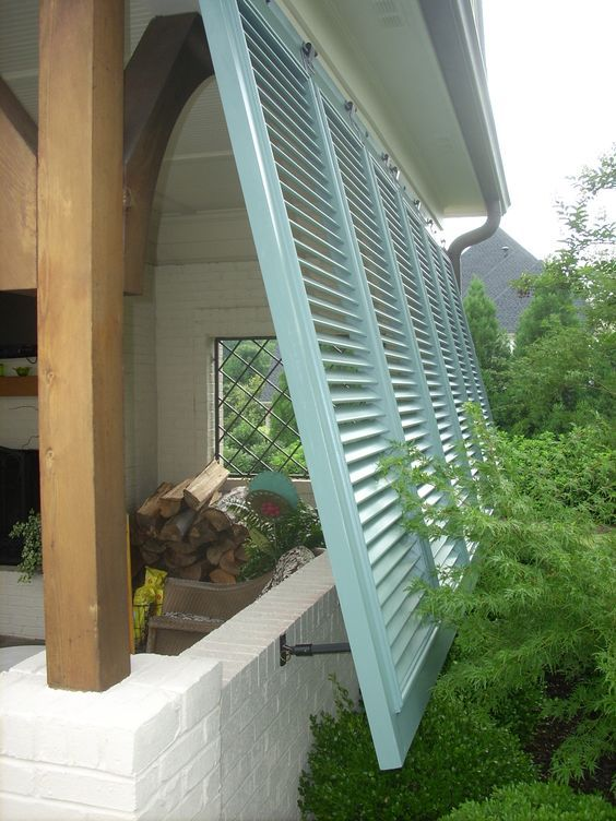 I LOVE the color of the shutters!!  Maybe on the side of the future deck??  Bermuda shutters on a porch.