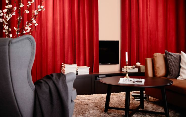 Take a cue from the cinema by hanging a couple of red curtains that can open and close for TV viewing times.