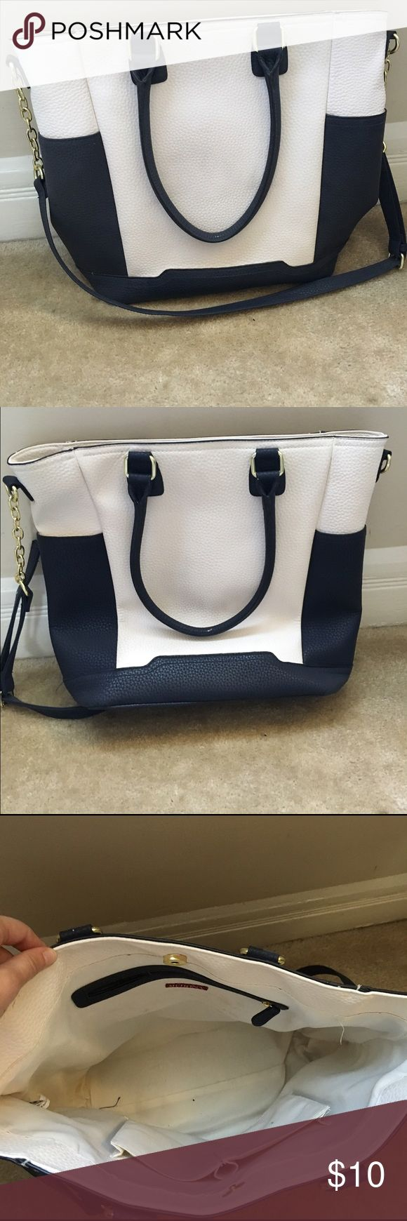 Blue and white tote bag Gently used tote bag. Great size for work or for an overnight trip. The white part is a little bit dirty but nothing a little TLC can't remove. Mossimo Supply Co Bags Totes