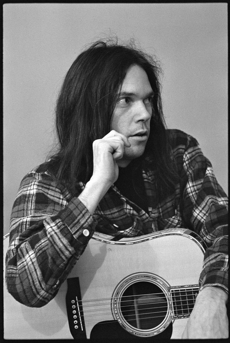 And good old Neil Young - he's never departed from his 1969-70s fashions -- he's still in a loose plaid shirt, t-shirt and jeans - oh he has a lot of new hats tho!