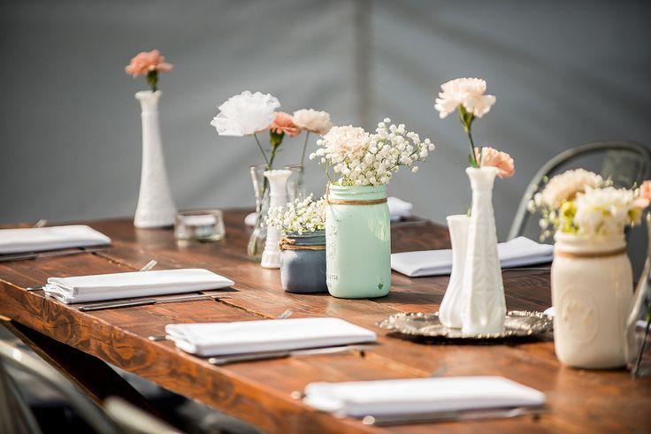 soft rustic vintage wedding decor with painted Mason jars