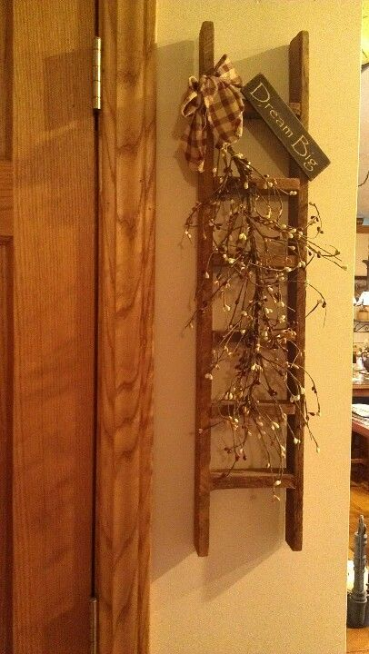 I have this same ladder w/ no decor on it. Now I know what to do w/ it!!! Yay!!!