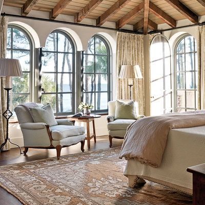 Master Bedroom with French club chairs - New Home with Old World Style - Coastal Living