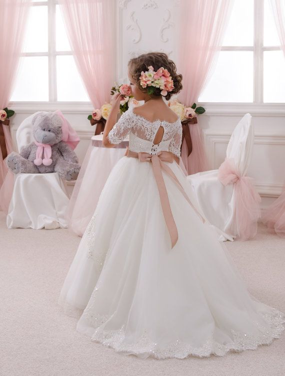 Beautiful ivory flower girl dress with multilayered skirt, corset with lace applique and rhinestones, zipper and lacing, and satin stripe with
