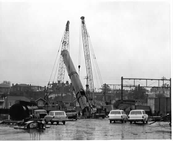 PH 8897. Construction of a smokestack for the new municipal refuse destructor in Surrey Road, Prahran; 11 September 1964.