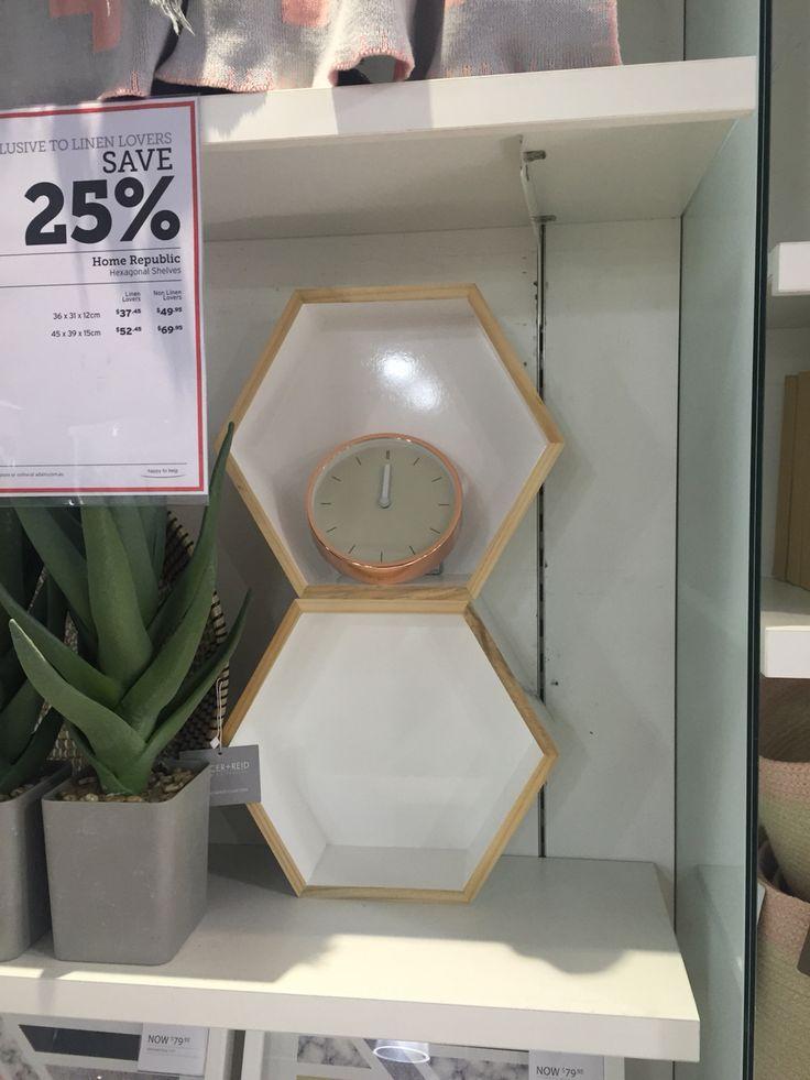 Hexagonal shelves and copper clock