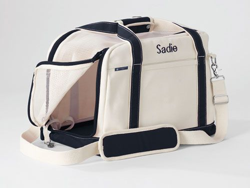 What to get a friend who loves her pooch? Instead of a leash or ball, try this Canvas Duffel Pet Carrier ($80). #gifts #holidays
